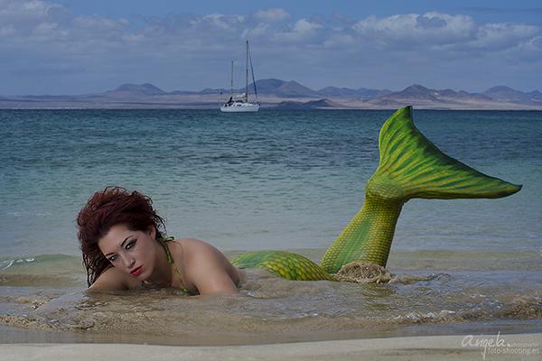 Meerjungfrau am Sandstrand